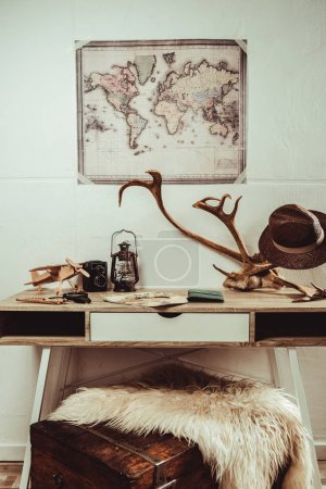 close up view of table with map, magnifying glasses and various decorations