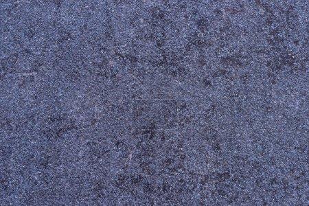 Detailed texture of purple granite wall