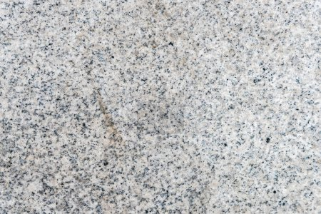 Detailed texture of light granite wall