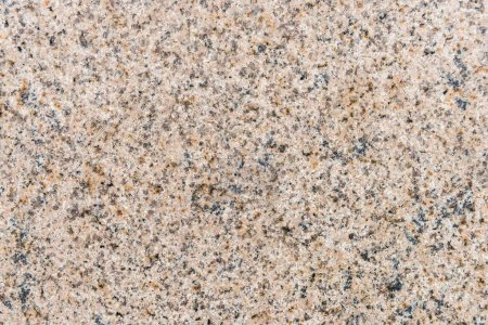 Beige granite stone wall background