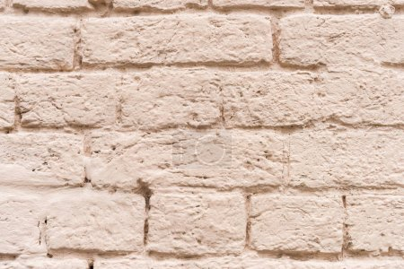 Brick wall painted in beige color