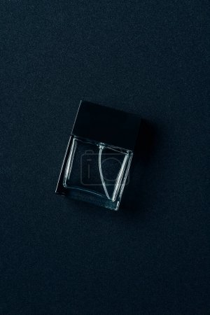 Photo for Top view of bottle of aromatic perfume on black - Royalty Free Image