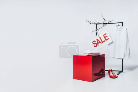 red cube, high heels and sale sign, summer sale concept