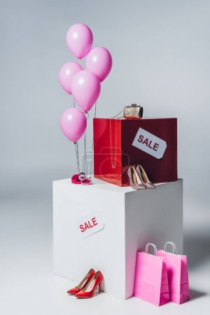 bundle of pink balloons, pink shopping bags and sale sign, summer sale concept