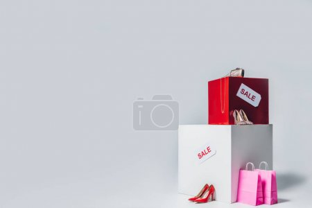 handbag, high heels, shopping bags and sale signs, summer sale concept