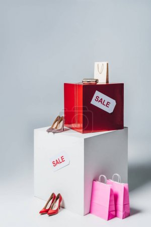 high heels, pink shopping bags and sale signs, summer sale concept