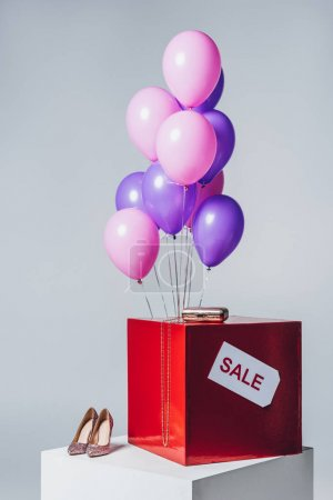 pink and violet balloons, high heels and sale sign, summer sale concept