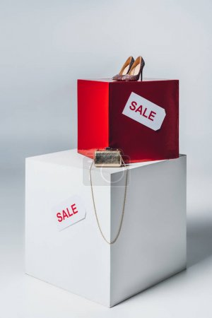 handbag, high heels and sale signs, summer sale concept