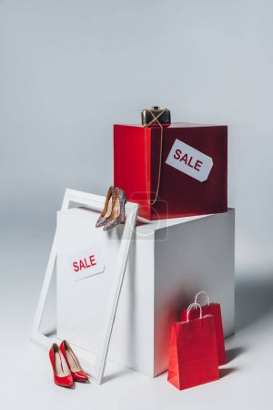 red shopping bags, high heels and sale signs, summer sale concept