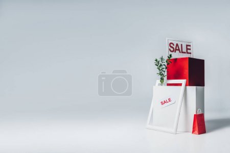 red and white cubes, paper bag and sale signs, summer sale concept