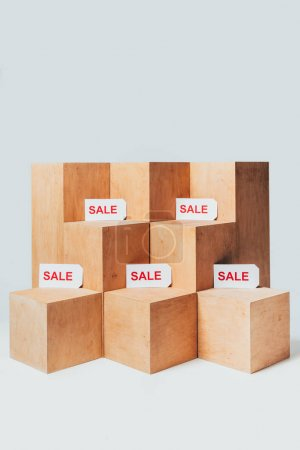 wooden stands with sale signs isolated on white, summer sale concept