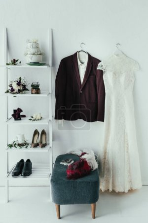 close up view of bridal and grooms clothing and accessories for rustic wedding in room