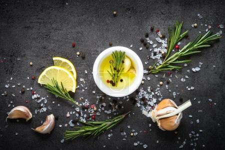 Photo for Selection of spices herbs and greens. Ingredients for cooking. Food background on black slate table. Top view copy space. - Royalty Free Image