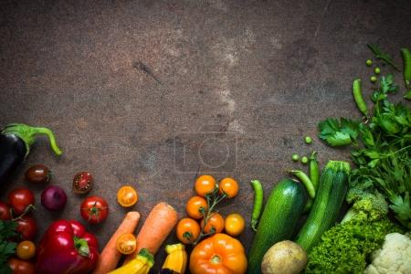 Photo for Organic farmer vegetables  at dark stone table. Vegetarian food background. Cooking ingredients. Top view copy space. - Royalty Free Image