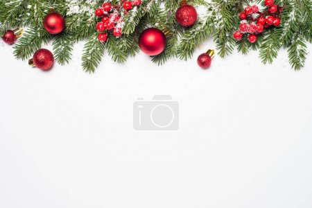 Photo for Christmas background. Snow Fir tree branch, red balls and berries on white background isolated. Top view with copy space. - Royalty Free Image