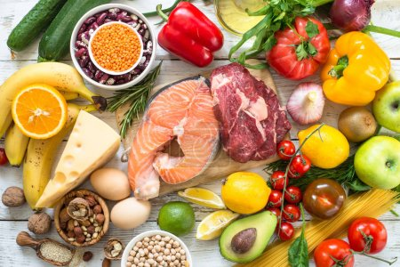 Photo for Balanced diet food background. Fresh food for healthy nutrition. Ingredients for cooking. Meat, fish, cereal, pasta, fruit and vegetables. - Royalty Free Image