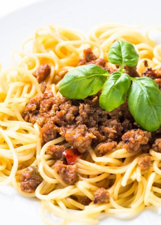 Photo for Spaghetti bolognese in white plate isolated. Traditional italian dish. - Royalty Free Image