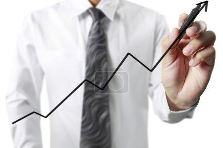 Photo pour Homme d'affaires dessin graphique un graphique en croissance - image libre de droit