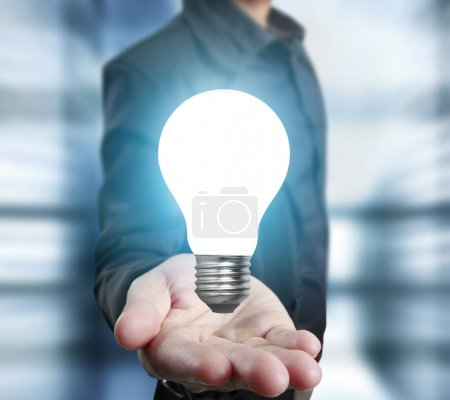 Photo for Hands of business person holding light bulb - Royalty Free Image