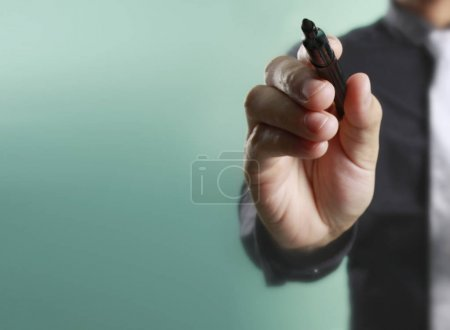 Businessman hand writing, drawing