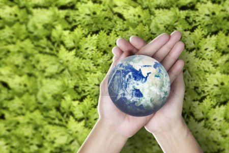 Photo for Globe ,earth in human hand, holding our planet glowing. Earth image provided by Nasa - Royalty Free Image