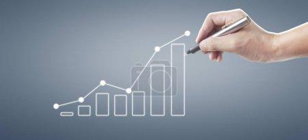 Photo pour Dessin à la main un graphique, graphique stock de croissance - image libre de droit