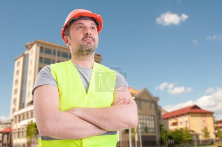 Successful constructor or architect with crossed arms