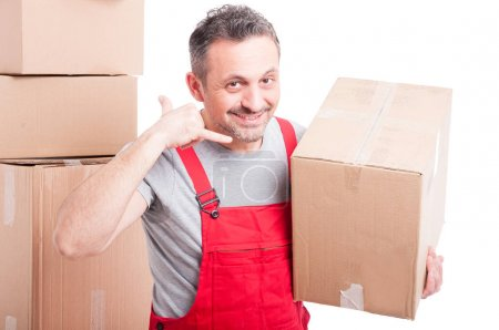 Delivery guy holding box and making calling gesture