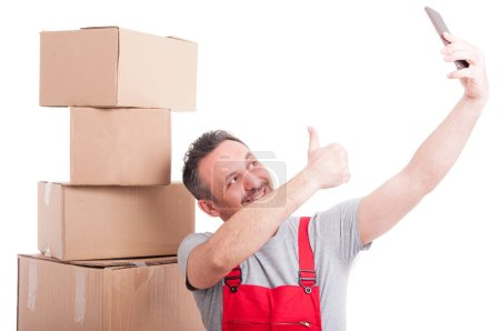 Mover guy making like gesture taking selfie and smiling