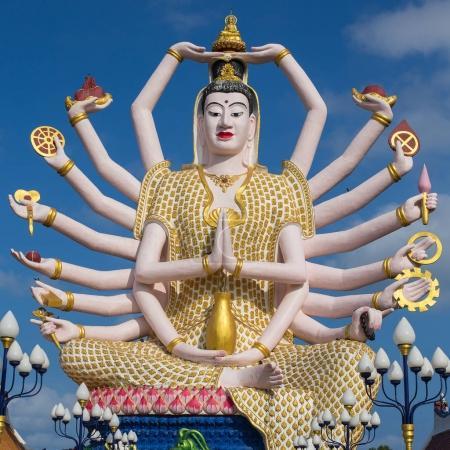 Wat Plai Laem temple with 18 hands God statue Guan...