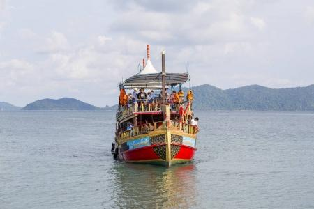 Colorful boat with tourists returns from a cruise to the island of Koh Chang, Thailand