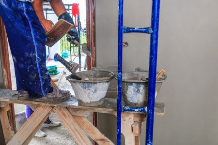 Plasterer concrete at construction site