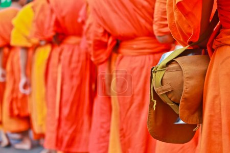 Photo for Buddhist monks in orange robe with bowl - Royalty Free Image