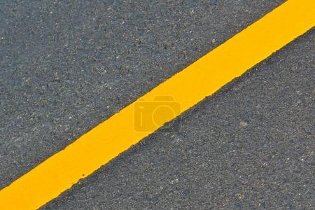 Long yellow road marking