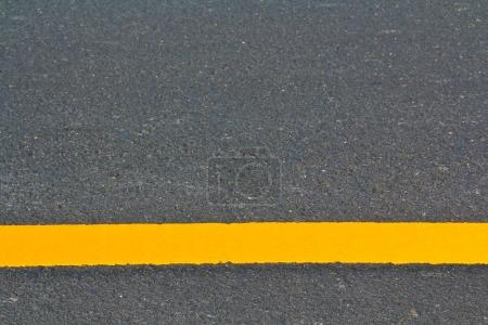 Photo for Long yellow road marking close up - Royalty Free Image