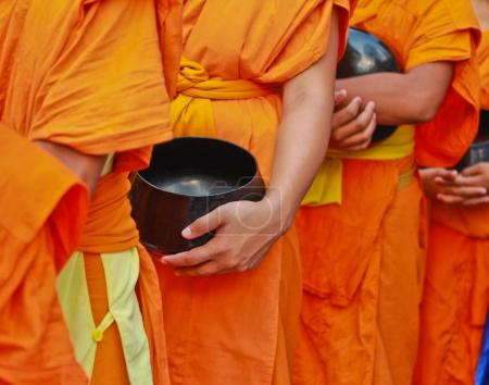 Buddhist monks in orange robes