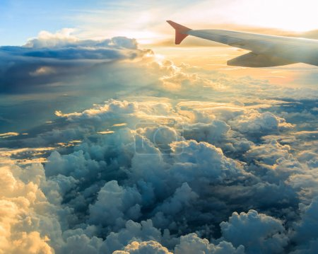 plane window and sunset