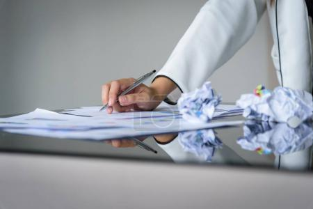 Hand of businesswoman holding with silver pen and playing a phon