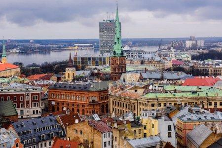 Photo pour LATVIA, RIGA - FEBRUARY 16TH, 2015: Aerial view of Riga city under cloudy sky at daytime - image libre de droit
