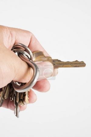 Photo pour Maintenant les clés de la maison sur fond blanc - image libre de droit