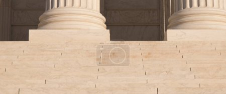 Close up photo of the steps and columns at The Supreme Court building in Washington, D.C..