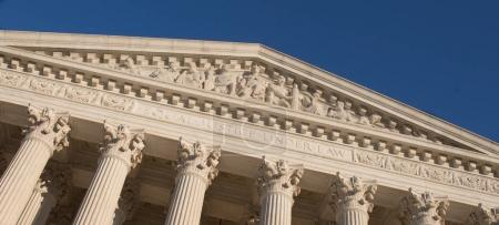 Close up of The Supreme Court Building in Washington, D.C. on a beautiful sunny day with bright blue sky.