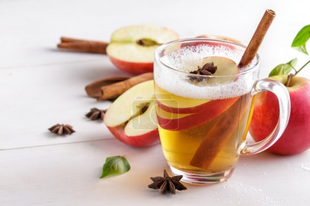 Hard apple cider with cinnamon stick