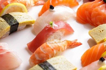 tuna nigiri sushi, prawn nigiri sushi, and tuna nigiri sushi