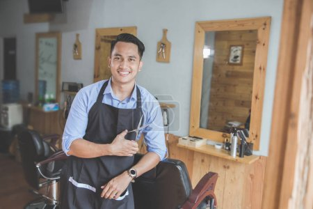 young male barbershop owner smiling