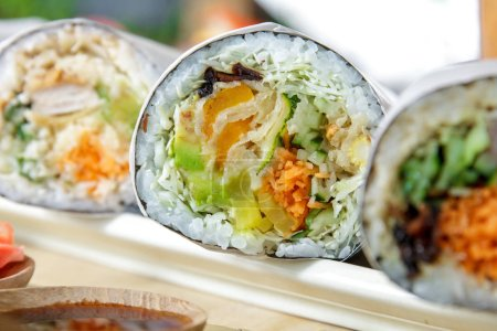 japanese sushi burrito roll served with wasabi