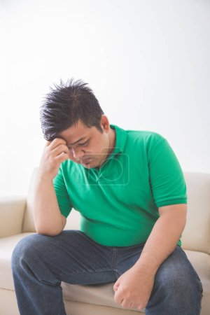 obese man thinking about his weight problem