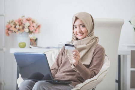 happy woman purchasing product via online shopping