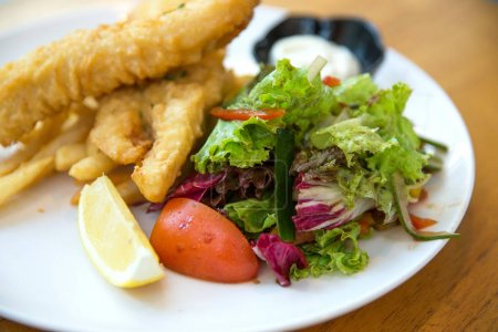 traditional British fish and chips with salads