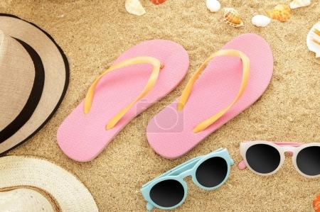 flip flops and sunglasses on beach sands